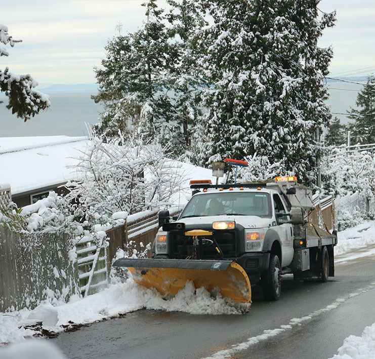 snow truck clearing snow on roadway