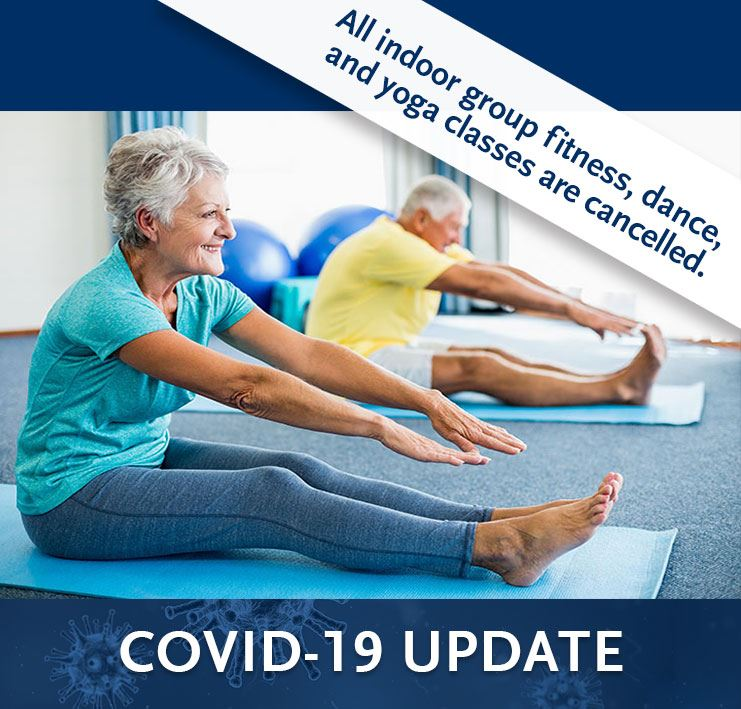 female senior sitting on yoga mat stretching - recreation classes cancelled due to COVID-19